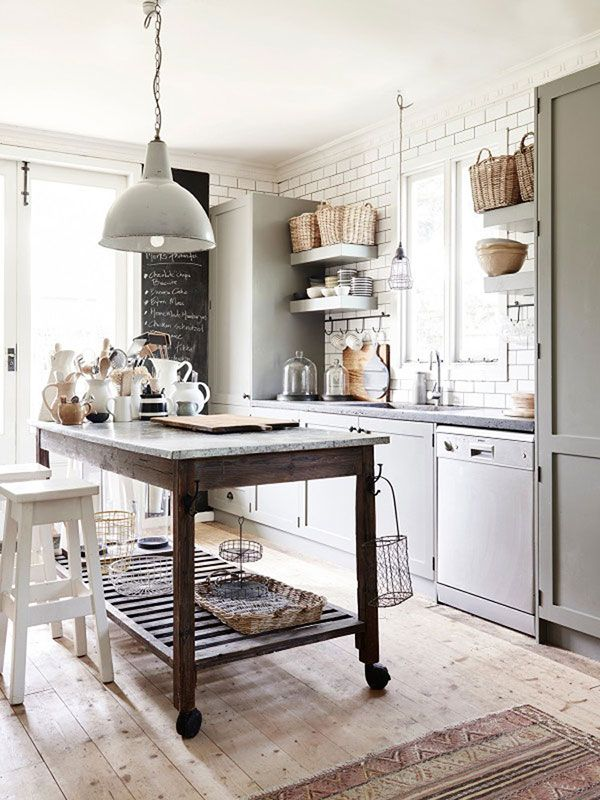 gray cabinets + white subway tile to the ceiling + large rolling kitchen island