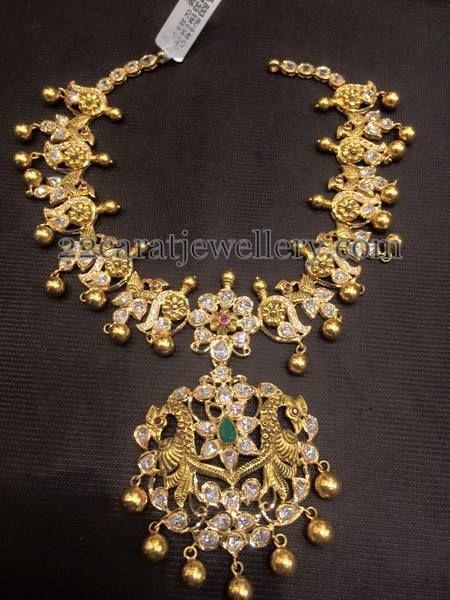 Jewellery Designs: Floral Antique Necklace Mango Jhumkas