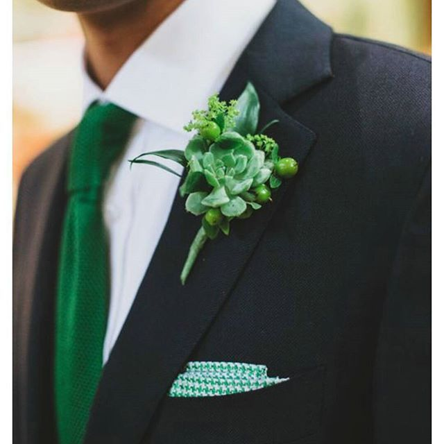 Green tie with green boutonnière