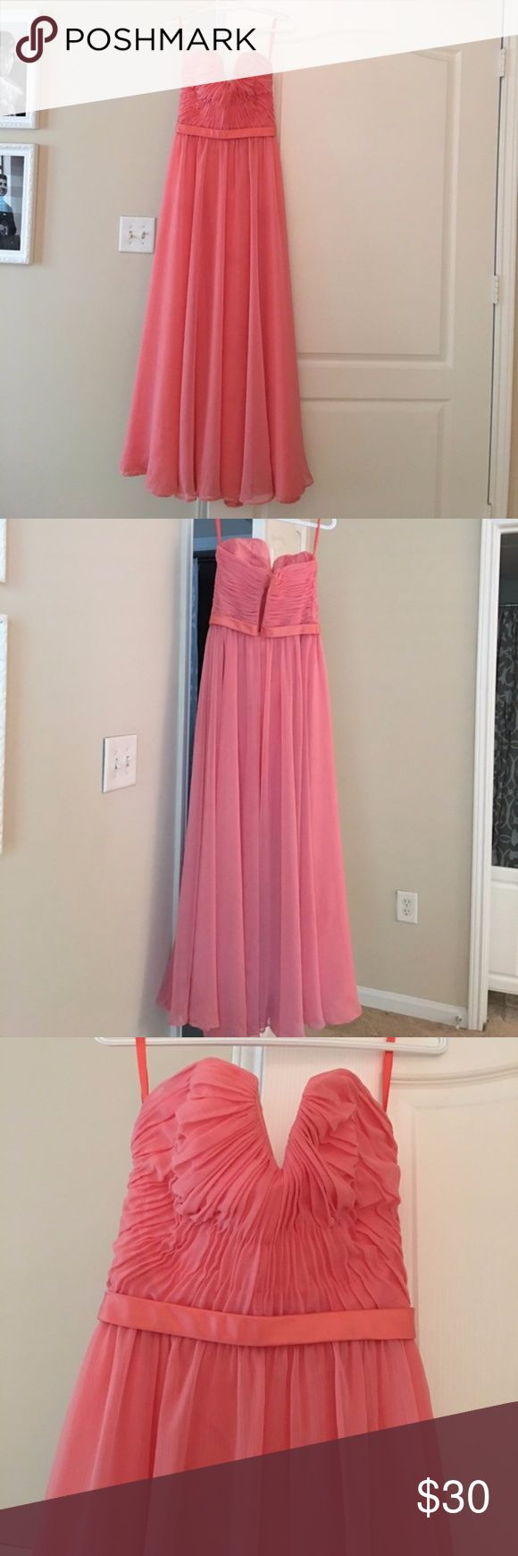 Coral Bridesmaid Dress Only wore once for a wedding... in good condition you can use the measurements for reference .....Bust:34in waist:26in Hips:37in  5'1 tall and wore 6in heels and dress was still about an inch long. The dress has a  very little rip and the bottom but you can barely see it. Angelina Dresses Wedding