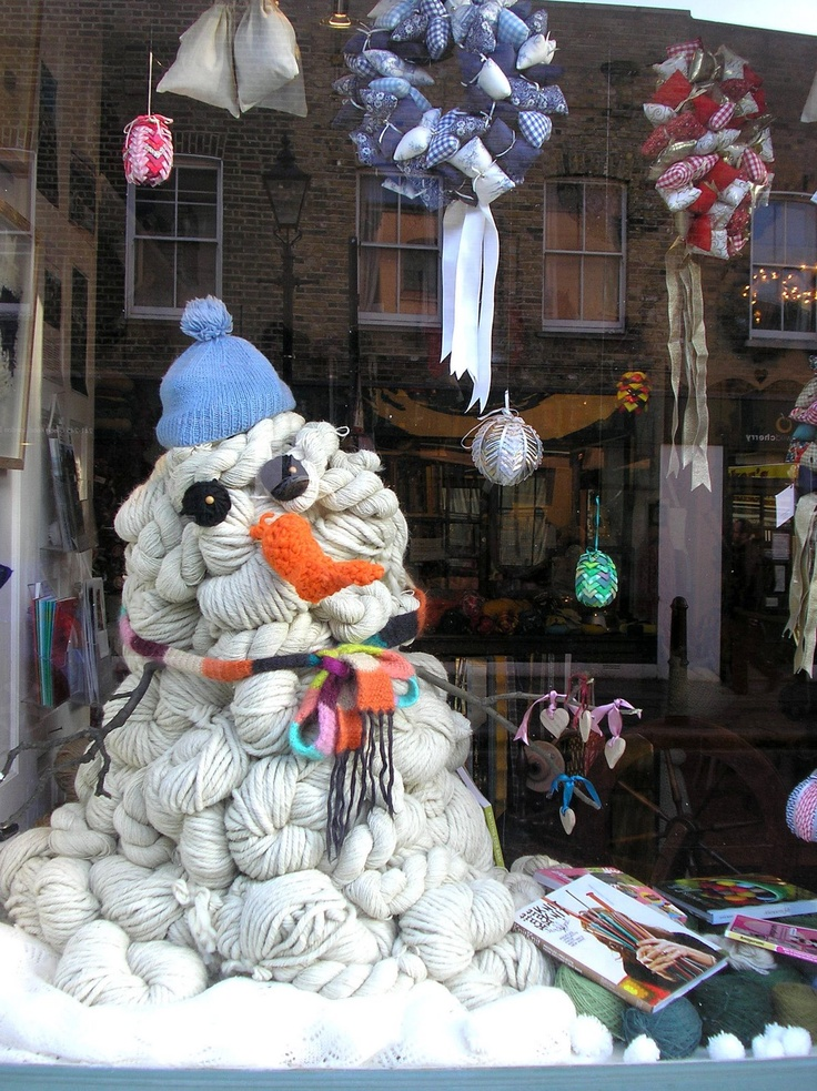 Snow man display at a yarn store.