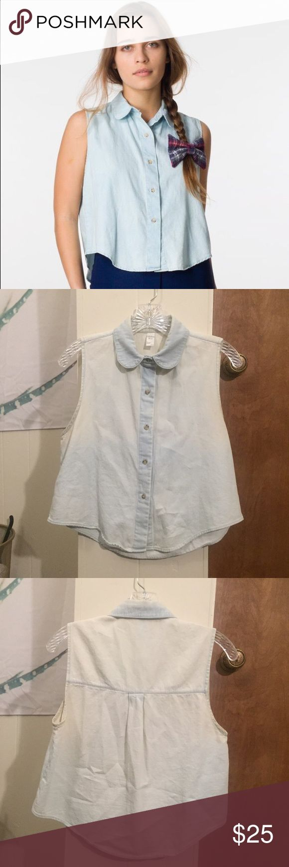 AA Sleeveless Denim Shirt Cute and classic. Tiny, light stain as shown in last picture, but otherwise in excellent condition! Size XS/S but fits more like a small. American Apparel Tops Button Down Shirts