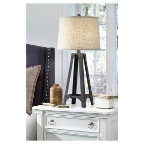 Truly riveting. Distressed metal table lamp brings an industrial-cool element into your space. Whether your style is vintage chic or urban hipster—what a great accent piece. Signature Design by Ashley is a registered trademark of Ashley Furniture Industries, Inc.