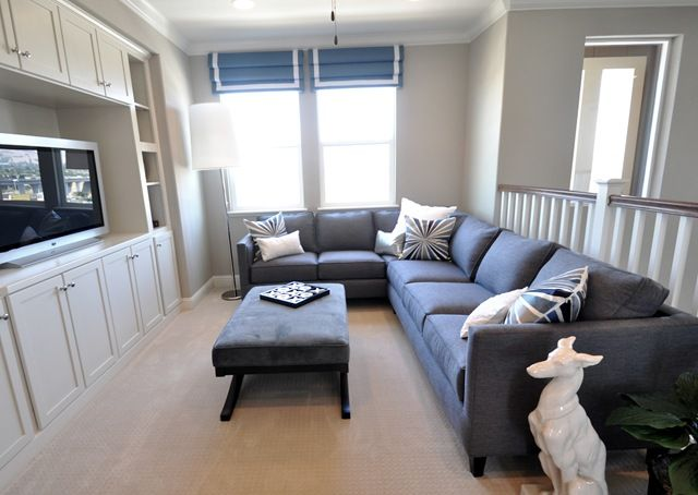 Upstairs there were several spaces I liked, the first was the loft.  I have gray sectional envy looking at this piece, it's so tailored and practical too.