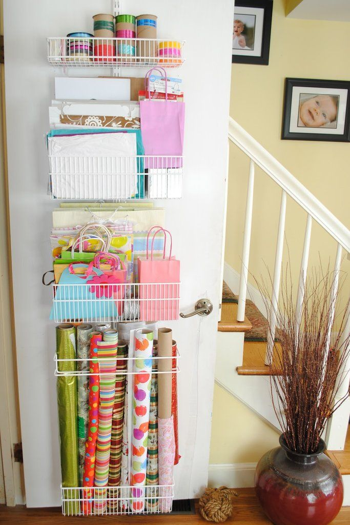 Install racks at the back of closet doors for a place to put your rolled-up wrapping paper. Source: The Chr...