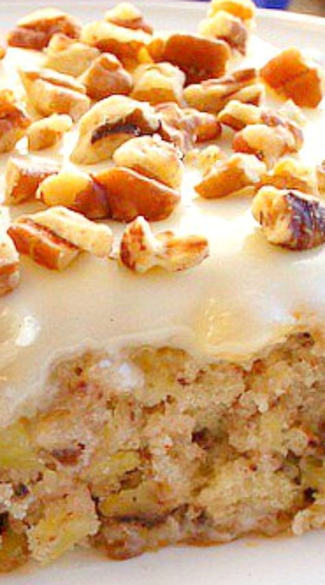 Easiest Pineapple Cake ~ It's incredible... a dense , moist, pecan, pineapple filled cake topped with a creamy cream cheese frosting