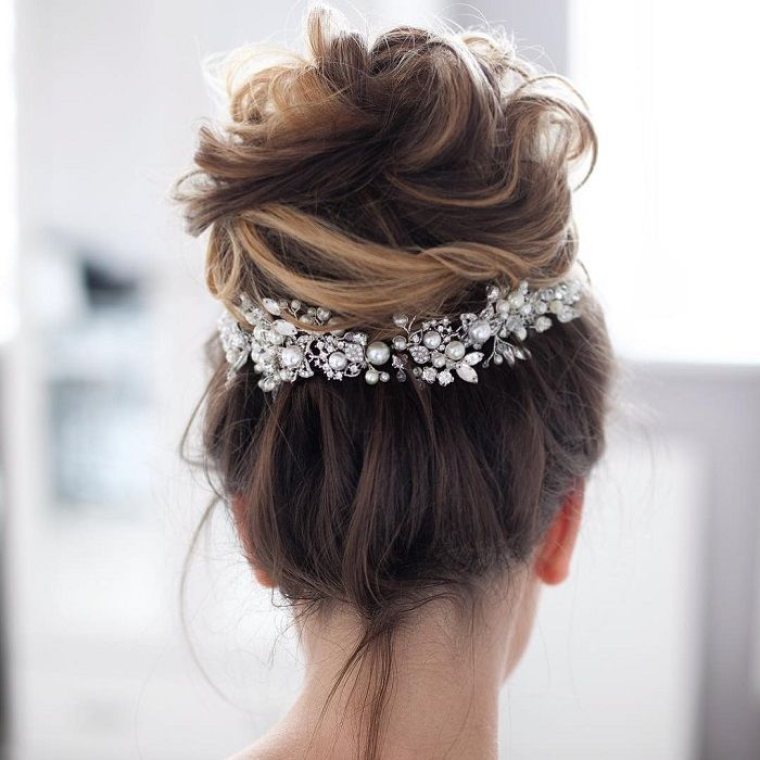 This messy up do is the perfect wedding hair for your special day