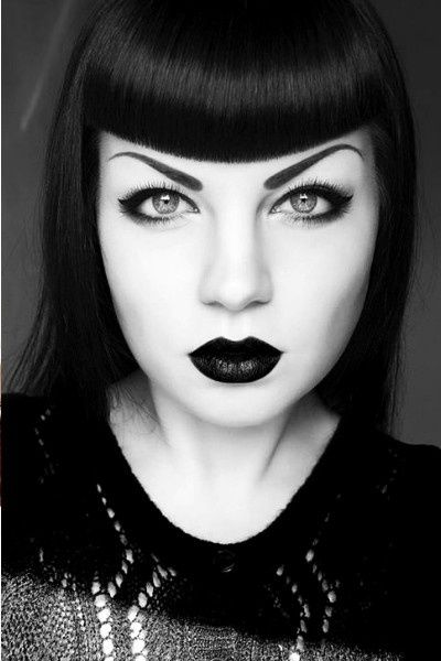 short black bangs and heavy makeup. gothic.