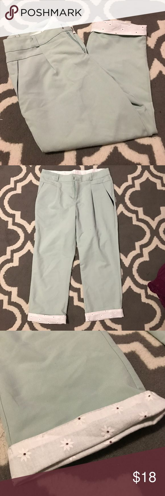 Mint capris with white flowered cuffs I love these pants as they are very cute and comfy but they have become too tight and I do not wear them anymore! Still in great condition I do not remember the brand and the tag was itchy so I cut it out. Pants Capris