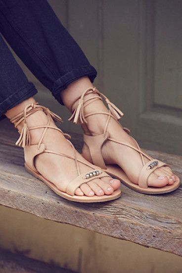 Bryn marr wrap sandal by FP Collection. These easy boho sandals are featured in a soft leather with subtle metal bead accents. Adjustable statement wrap ties...