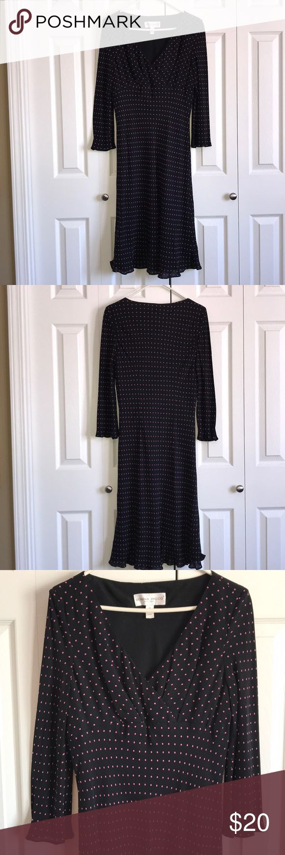 Donna Ricco Polka Dot Dress Like new Donna Ricco, 100% silk dress. Knee-length. 3/4 sleeves. VERY comfortable and shows off curves perfectly. Dress is black with pink polka dots. Not super low cut, but low enough to flaunt what you got. Size 10. Donna Ricco Dresses Midi