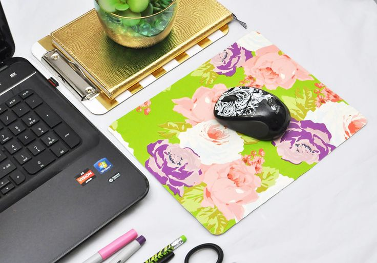 Learn how to create a custom mouse pad using recycled cardboard and wrapping paper - this couldn't be any easier or any cheaper to make!