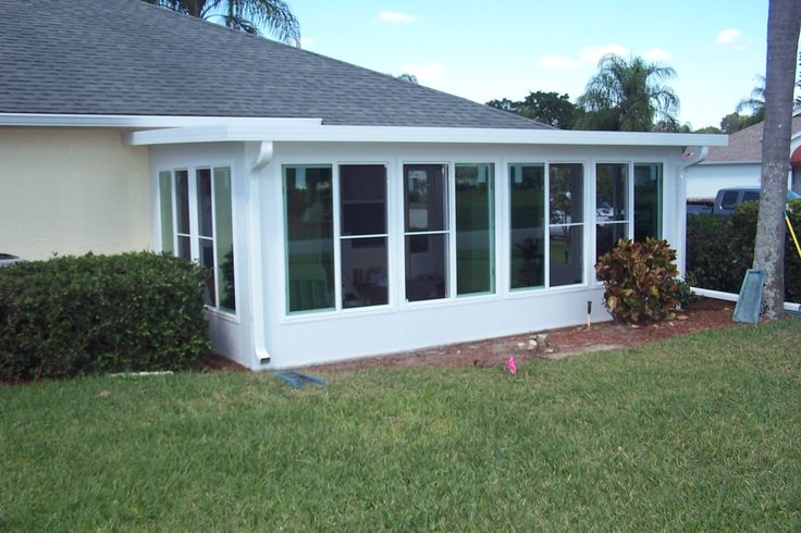 Sunroom Decor Ideas : Aluminum Sunroom Simple House Building Adorable Flat Roof White Wall Color Nature Green Grass Secret Glass Window Can See From Inside Best Aluminum Sunroom Addition into Existing Porc Sunrooms For Sale. Champion Sunrooms Patio Enclosures. Sunrooms Add Ons.