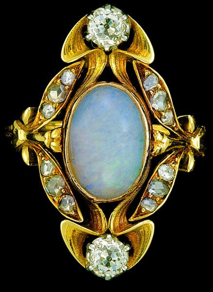 ART NOUVEAU Ring with an oval center opal and diamond accents. Set in gold…