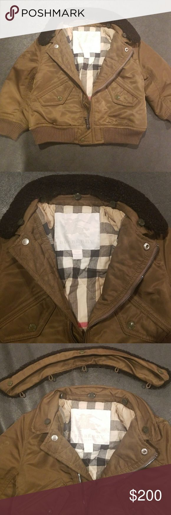 12 month burberry bomber jacket 12 month green burberry bomber jacket.  Can attach unattach neckline. Has a water mark on right and left arm. Burberry Jackets & Coats