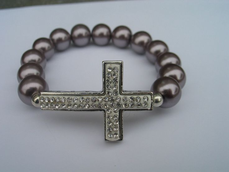Sideways cross bracelet with clear diamond style encrusted beads. $15.00, via Etsy.