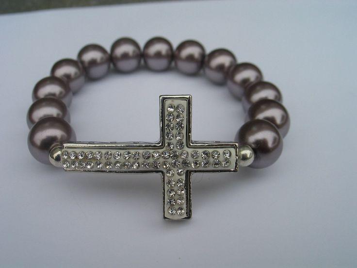 Sideways cross bracelet with clear diamond style encrusted beads. $15.00, via Etsy.