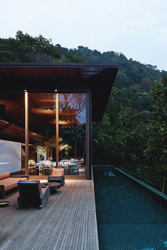 house with a forest view and the pool