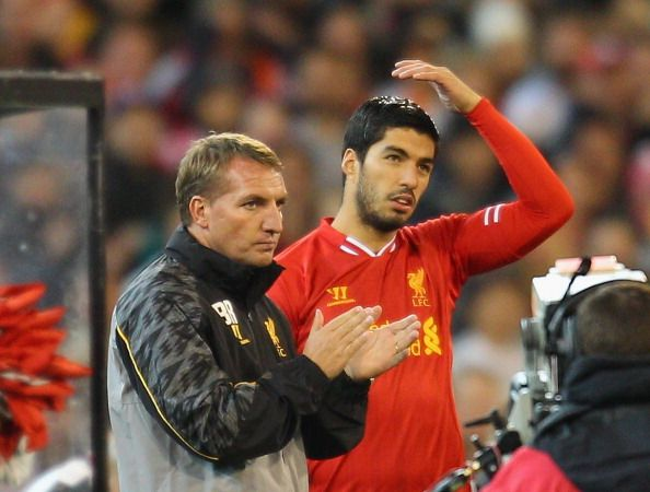 Liverpool FC Manager Brendan Rodgers (L) looks on as Luis Suarez of Liverpool is substituted into the match during the match between the Melbourne Victory and Liverpool at the Melbourne Cricket Ground on July 24, 2013 in Melbourne, Australia