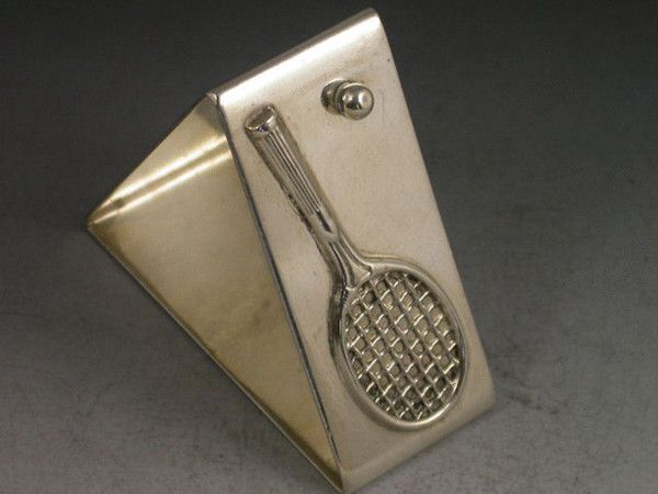 Silver napkin ring with applied tennis racquet and ball. Made in Birmingham, UK, 1927