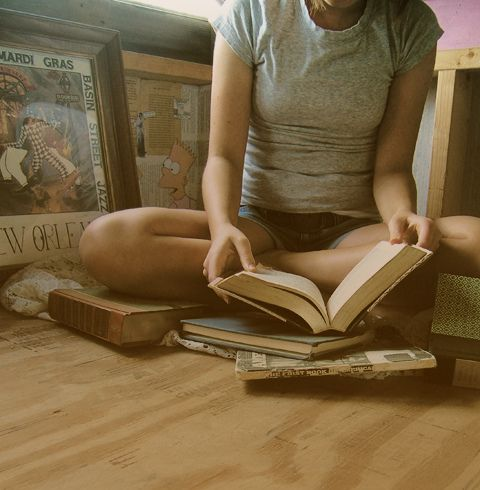 The books spread around me, all open, all staring up at me with stories longing to be read.