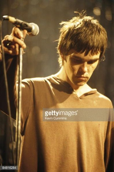Singer Ian Brown performing with Manchester rock group The Stone Roses, circa 1995.