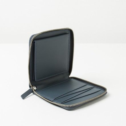 The Womens Square Zip Wallet - Blue Grey - Everlane. Love the color and zip; wish it had an ID pocket, but since those tend to crack (read: the reason I'm looking at new wallets in the first place), maybe it's not worth holding out for.