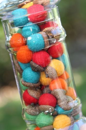 Painted acorns in bright colors. Too cute!