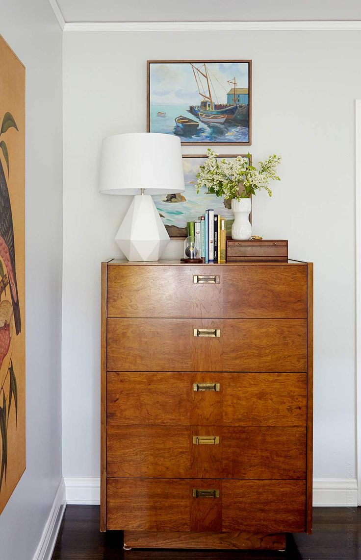 Master bedroom makeover by Emily Henderson Resources:  Dresser, vintage.  Lamp, LampsPlus $166.91, Vase, roost.  8 ball in dome, New Stone Age.  Brown leather jewerly box, Pottery Barn.  Huge bird Painting, Dwell Studios, $1195.  Antique paintings framed at Curve Line Space.