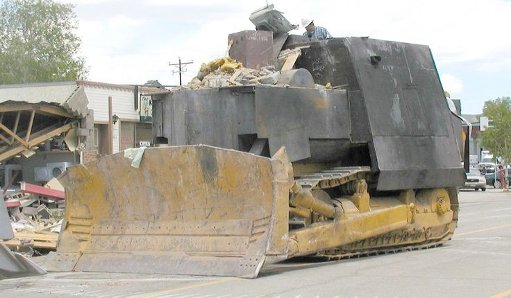 Marvin John Heemeyer, an American welder and an automobile muffler repair shop owner most known for his rampage with a modified bulldozer. Outraged over the outcome of a zoning dispute, he armored a Komatsu D355A bulldozer with layers of steel and concrete and used it to demolish the town hall, the former mayor's house, and other buildings in Granby, Colorado. The rampage ended when the...