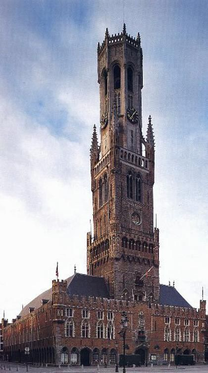 The Belfry Tower Of Bruges Dating From 1240 And Towering Above Cloth Hall Which In 1399 Was Occupied By 384 Sales Stands Offering Flanders
