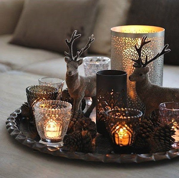 Collect various candle holders and small glass jars to serve as your Christmas candles' fortresses. Add miniature deer figures to complete the look for your centerpiece.