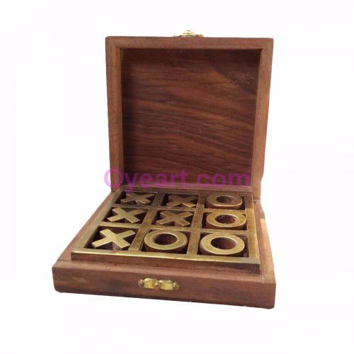 We are presenting you this #game of tic tac toe made in hard rose wood box with 0's and X's made up of same #wood and top brass #inlays as shown in #pictures. The box is #beautifully #designed making the game easy to carry. The #simplicity of tic-tac-toe makes it an ideal tool for #teaching the concepts of combinatorial game theory and the branch of #artificial #intelligence.