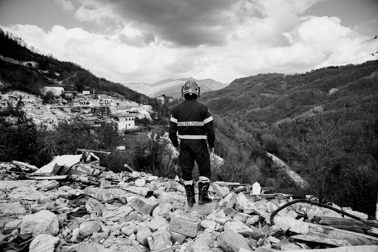 A fireman walks over the ruins of Pescara del Tronto a small town in Marche that was completely destroyed by the two earthquakes of August and October in Central Italy. This picture is from my upcoming project about the earthquake aftermath in Central Italy. I'm available for assigments regarding this argument write at info@giancarlomalandra.it #reportage #blackandwhite #Italy #amatrice #earthquake #aftermath #destruction #lazio #umbria #marche abruzzo #photography #photooftheday…