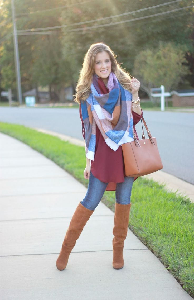 Burgundy blouse with jeans and tan boots, patterned scarf - fall style