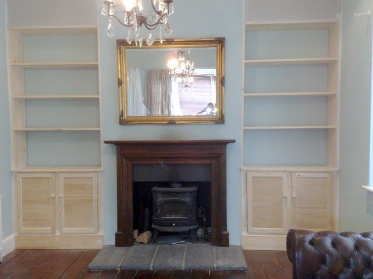 custom-built alcove shelves with cabinets