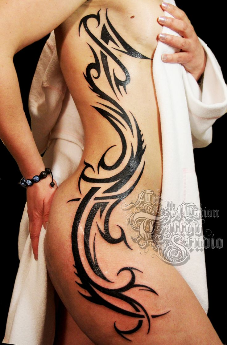 Back celebrity tattoos our search for tribal tattoos home - Free Hand Tribal Design Art In Motion Tattoo Studio