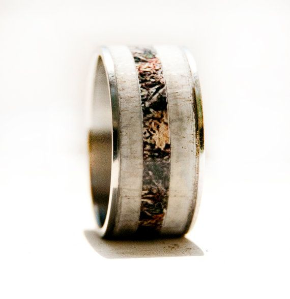 Hey, I found this really awesome Etsy listing at http://www.etsy.com/listing/157600883/camo-ring-with-antler-and-titanium-ring