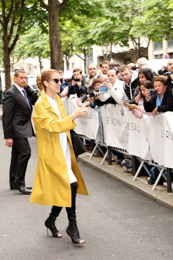 Pin for Later: Celine Dion Is the Fearless Fashion Icon You Didn't Know You Needed Celine's Bright Mustard Coat Looked Cool, Not Overly Quirky