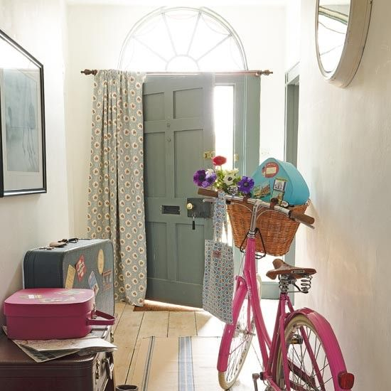 For a traditional country look, try using vintage luggage as a stylish decorating idea that will also double up as storage