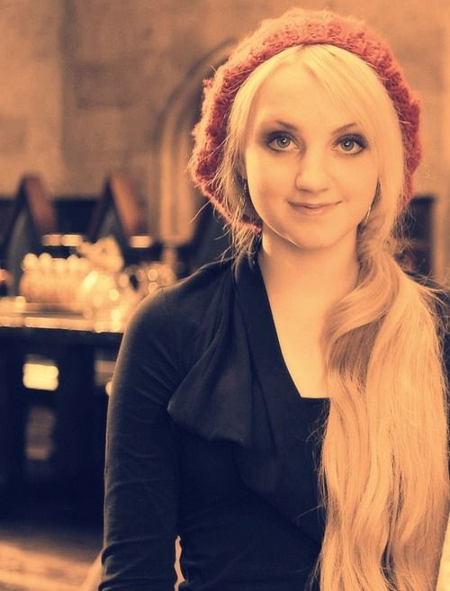 Evanna Lynch. I really like her hat and look at the background, it's the Great Hall!
