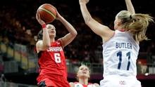Canada's Shona Thorburn (6) shoots as Great Britain's Kim Butler (11) and Johannah Leedham (13) defend during the first half of a preliminary women's basketball game at the 2012 Summer Olympics, Monday, July 30, 2012, in London. (Eric Gay/AP)