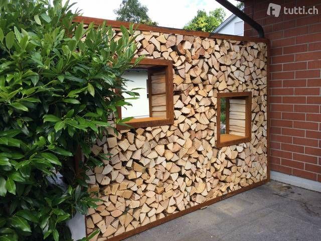 Sichtschutz, Eisenrahmen für Holz, Holzlager in St. Gallen