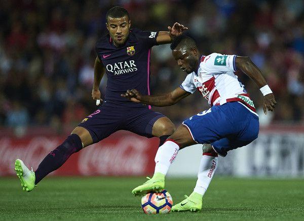 Uche Henry Agbo of Granada CF (R) being followed by Rafinha Alcantara of FC Barcelona (L) during the La Liga match between Granada CF v FC Barcelona at Estadio Nuevo Los Carmenes on April 02, 2017 in Granada, Spain.