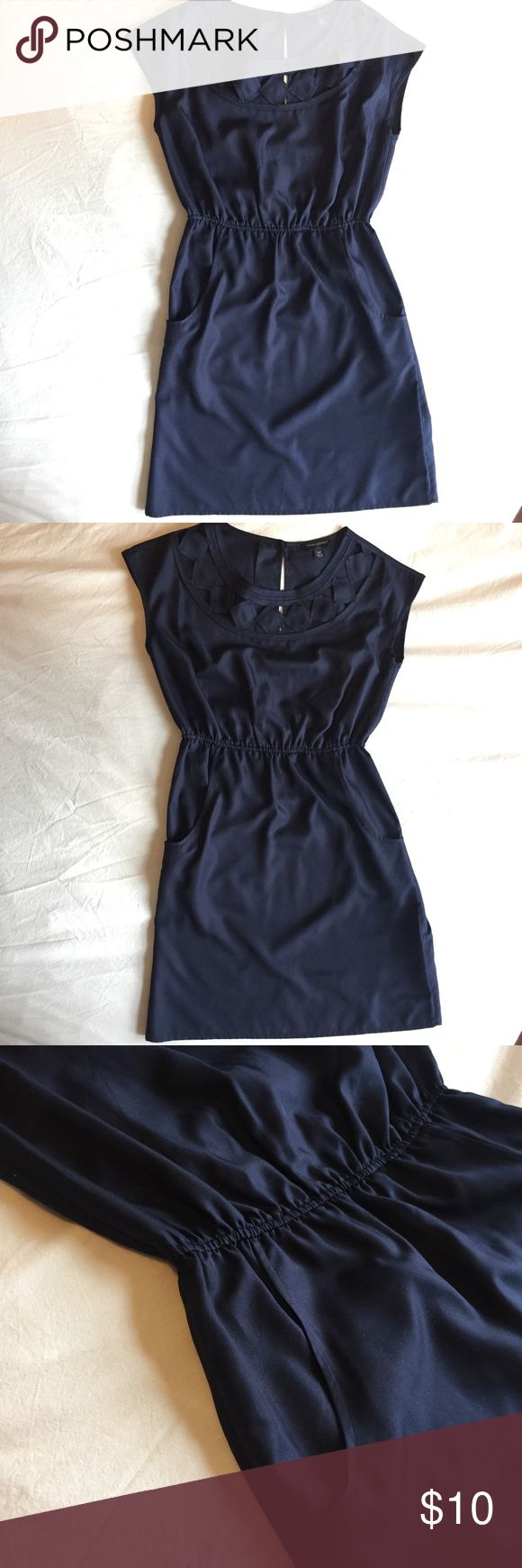 Banana Republic navy dress Banana Republic navy dress, simple but flattering silhouette with some detail around the neckline - and pockets!!  Elasticized waist for some definition and two bronze buttons in the back along neckline, for on/off.  Fabric is silky / smooth feeling.  Simple and versatile - for a dressy workday or casual night out. Banana Republic Dresses