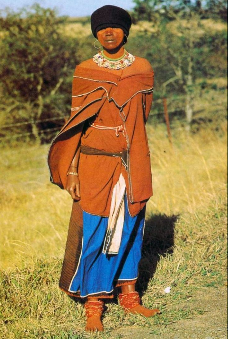 Africa | Xhosa woman with an ochred skin, the traditional painted appearance of the women of the tribe.  South Africa || Postcard; publisher Constantia.  Photo J. Morris.