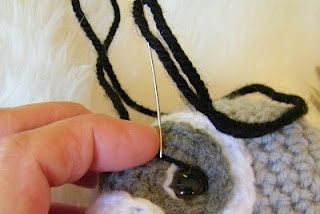 sculpting the eyes on a crocheted amigurumi.