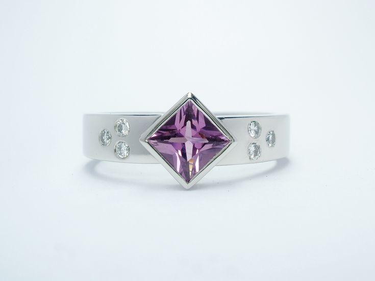 PURPLE SAPPHIRE DIAMOND & PALLADIUM - Square princess cut rub-over set purple sapphire and flush set diamond ring mounted in palladium.