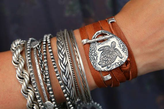 Nautical Jewelry, Sea Turtle Beach Wrap Bracelet: This nautical leather bracelet wraps about 5 times, and cleverly fastens with a handmade sterling silver toggle clasp. A baby sea turtle swims amidst the kelp forest for a pretty beachy allure. A few silver accent beads can be slid on top