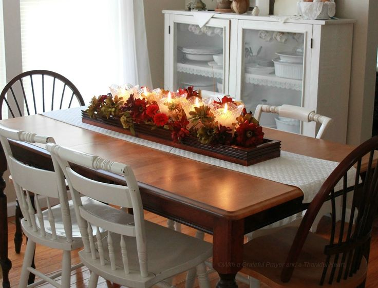 Best 25 dining table centerpieces ideas on pinterest for Kitchen table arrangement ideas